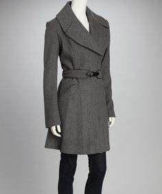 Stand out in style on even the chilliest day with this luxurious wool-blend coat. An oversize collar enhanced with chic slits frames the face, while a faux leather-trimmed belt adjusts to cinch the waist.