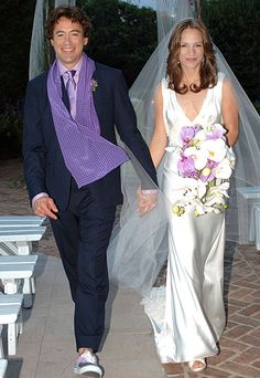 & SUSAN LEVIN At Robert Downey Jr. and Susan Levin's 2005 wedding, the couple wed under a gazebo as guests like Billy Joel and Sting watched from white wooden benches. In keeping with the relaxed tone, the groom wore sneakers. Susan Downey, Robert Downey Jr., Robert Downey Jr Family, Celebrity Wedding Photos, Celebrity Wedding Dresses, Celebrity Weddings, Hollywood Wedding, Star Wedding, Groom Wear