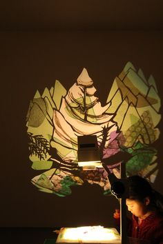 """Interactive overhead projector installation by Mind of a Snail at Vancouver Art Gallery for BC Family Day (Feb 10 2014). Based on Emily Carr's """"Deep Forest"""" paintings."""