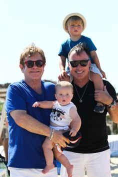 Elton John and husband David Furnish treat their baby boys to a day on the beach 2014