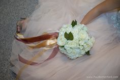 white rose wedding bouquet photo castle farms beautiful fall wedding with allure bridal, thyme hill design, muscles and mascara, nina shoes photo by Paul Retherford Photography #castlefarms #puremichigan #wedding #weddinginspo #weddinginspiration #weddingday #allurebridals #ninashoes #thymehilldesigns #castle #nomiweddings #upnorthbride #northernbride #Brides