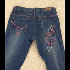 Fashion Jeans Cute and colorful embroidered, crop jeans (19 inch inseam). Beautiful flower pattern on back with colorful stitching around the pockets. Cap on button is missing. Jeans Ankle & Cropped
