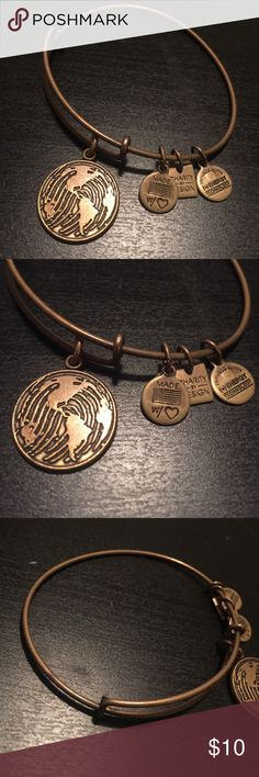 """Alex & Ani Russian Gold """"make your mark"""" bangle This bracelet is from the Charity By Design collection. The charm is a fingerprint overlaid with a world map. Great for travelers! Not that shiny but also not tarnished! Adjustable to fit any size wrist.  Alex & Ani Jewelry Bracelets"""