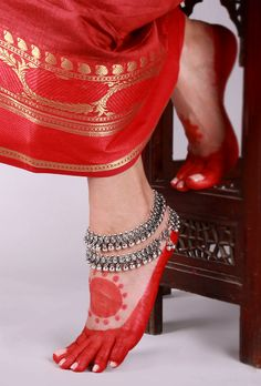 Silver Ghungroo Lambani Anklet Traditionally, the Lambani women folk wear jewelry made out of copper, white metal and silver. Trying to revive the traditional lambani jewelry we have curated a collection of 22 carat gold and silver plated anklets.