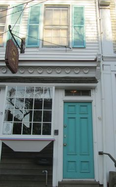 adorable building on Main Street in Sag Harbor, New York with the cutest turquoise door and shutters.