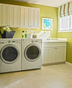 Love the convenience of built-in cabinets and a laundry room sink! [Dundee home in Bonney Lake, WA]