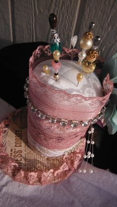"Victorian Pink Pin Cushion - Elegant pin cushion is a must in a sewing room, this is made with vintage lace, bling, flowers, pearls and comes with handmade hat pins and blank pins. Measures at 5"" tall, please go to shop to see more by clicking on this picture twice."
