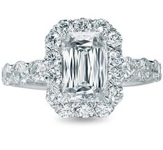 Different diamond, but same style. Cushion cut with a double band.