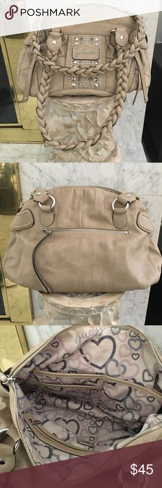Guess Purse Authentic Guess Purse from Guess store. Tan leather with cute interior. Has many pockets. Used once or twice. Looks brand new. Guess Bags Shoulder Bags