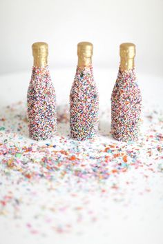 everythingsparklywhite:  Champagne bottles covered in sprinkles. I don't know what I could love more…  Tell them that it's my birthda...