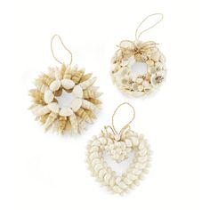 Shell Wreath Ornament. Jingle shell. Natural assorted seashells are arranged to create our wreath ornaments.