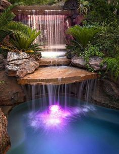 Awesome lighted waterfall to turn the backyard pool into a tropical oasis