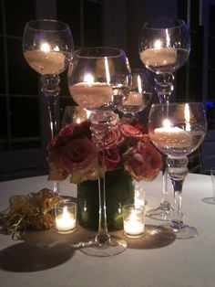 Floral centerpiece by Kim Wise  Candles by Luminous Events  Event Design by All About Events