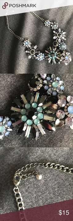 Forever 21 flower necklace Like new silver flower collage necklace is so beautiful and shiny with black, turquoise, blue and clear diamond like gems. Sit right on the collar bones. Forever 21 Jewelry Necklaces