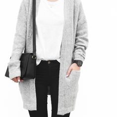 |gray cardigan + white shirt tucked + black jeans + black watch|