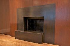 Blackened steel fireplace surround with custom bronze patina. Fabricated by Iron & Wire. | Yelp