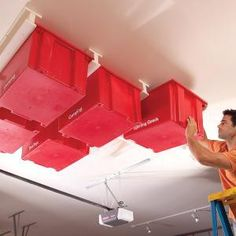 Ashbee Design: Ideas for Garage Storage--Utilize ceiling space! Place in bins and label on the bottoms so you can see what you've placed in them. eg. Frisbees, basketballs, volleyballs, yard ornaments, etc.
