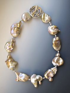 """Necklace by Myra Schwartz, $525 Lustrous 25mm-28mm Keshi pearls, indescribably delicious natural pink color with sterling toggle, 19"""" long, comes in wood presentation box."""