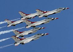 Air Force Thunderbirds....I lived across from the Air Force Academy for 5 years.....loved sitting on my deck watching then perform for the graduation.......sooo cool
