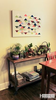terrarium plant table with triangle artwork painting
