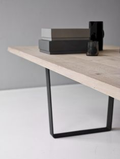 The LOWLIGHT TABLE was designed by Jacob Plejdrup in developed on the plank table concept and characterized by an open and slightly sloping base. Solid Wood Table Tops, Wooden Table Top, Oak Table, Dining Room Table, Table And Chairs, Inexpensive Furniture, Cheap Furniture, Furniture Design, Furniture Market