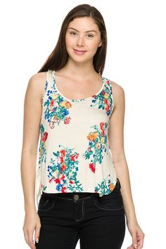 Floral print hi-lo top with sheer back contrast.