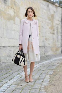 Gorgeous pastel dress with black ribbon, chic coat dramatic black and ivory bag!