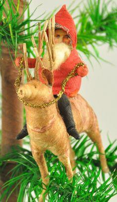 Spun cotton santa on a reindeer