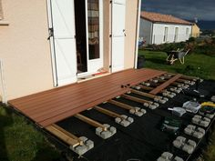 pose terrasse lame composite sur plot beton