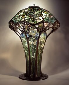 Library lamp, c. 1900. No. 146, Cobweb design shade, mosaic floral base [oil lamp conversion]; leaded glass, mosaic, bronze; Tiffany Studios, New York City, 1902–32; H. 30 in. (62-020).
