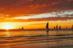Sailboats at sunset along White Beach Boracay, Philippines