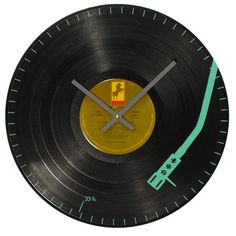 Turntable Arm Wall Clock by WrecordsByMonkey - The Turntable Arm Wall Clock is made from a vinyl record and features the image of a turntable arm playing a track. Despite the throwback materials and shape, this timepiece is totally contemporary.
