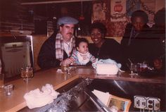 Infant me my mother & father at a bar because that's how parents rolled in the early '80s