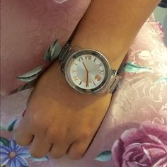 Movado Bold PRICE IS FIRMPre-loved, barely used. Authentic, box included. Boyfriend style. 39mm case size. Model # 3600196 silver stainless steel with rose gold tone sun ray dot and roman numeral. Push-button deployment clasp. Will fit wrist up to 6.5-7 Movado Accessories Watches