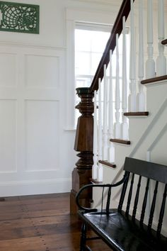 FOYER – nice woodwork, staircase, entry bench and white walls.