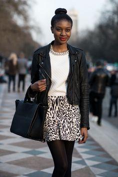 pretty lady + patterned skirt + leather jacker