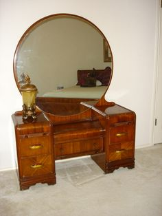 My dream is to have (and have room for) an art deco waterfall vanity just like this-with a little bench to sit on. Perfection!
