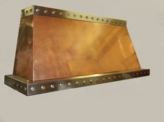 Copper Range Hood with Bronze Rivets