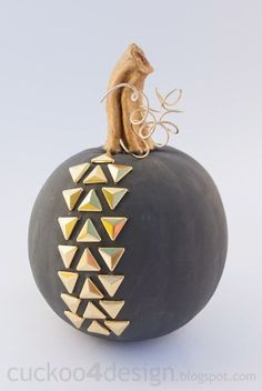 Add texture to an otherwise smooth surface with triangle studs (found at most craft stores). Click through for a tutorial and more Halloween pumpkin decorating and design ideas.