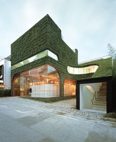 Ann Demeulemeester Shop surrounded by vertical gardens Cheongdam Ward Gangnam District Seoul South Korea via Classy Bro Amazing Architecture, Landscape Architecture, Interior Architecture, Gangnam District, Gaudi, Paris Apartments, Ann Demeulemeester, Green Building, Sustainable Design