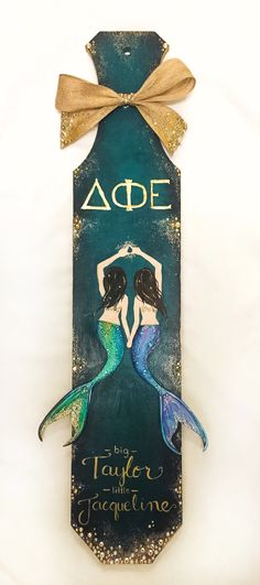 I like the mermaids. D Phi E Mermaid Sorority Paddle Alpha Phi Omega, Delta Phi Epsilon, Phi Sigma Sigma, Tri Delta, Big Little Paddles, Sorority Big Little, Paddle Sorority, Sorority Life, Greek Paddles