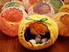 """Yarn Eggs for Easter Sunday School class- wrap balloon in yarn you like -leave lots of nice """"gaps"""" as wrapping. Mix 1/2 bottle glue w 1/2 bottle water, pour into bowl, swirl yarn covered balloon in it, let drip in collander, then sit on wax paper turning periodically for about 2 days. should be hard. works better than fabric stiffener from michaels - i tried both. cut hole, attach embellishments, wa-la! what fun!!!"""