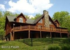 This magnificent log home is one of a kind with too many features to mention. Set on 3.33 acres in a private gated community with 7 bedrooms, 6 baths, open floor plan with cathedral ceilings, master suites, chefs dream kitchen with large island, central AC, central VAC, heated 2 car garage, paved driveway, wrap around deck, security alarm, generator, fenced in yard and the list goes on. Move in to this immaculate home and bring the family to enjoy the pristine lake and the privacy of an…