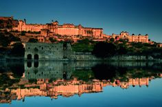 Mughals and Palaces Tour - The Amber Fort across the lake #India #Holidays #Travel