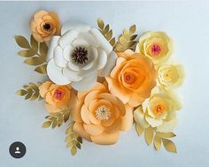 MOUNTED PAPER FLOWERS Pretty, romantic, feminine, elegant, vintage, sunny, timeless... I've had the pleasure of creating beautiful paper flower backdrops in a range of delightful styles for celebrations, events and home decor. Every single petal is hand-cut and made to your