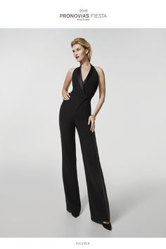 Masculine elegance has taken over this tuxedo-style jumpsuit, fitted at the waist, made in crepe with satin details on the sides of the trousers and the cross-over halter neckline. Gemstone details add shimmer and shine to this stylish outfit, full of character.