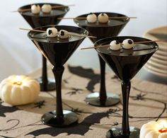 Eerie eyeballs make this creepy cocktail perfect for Halloween. Black martini glasses great for ghoulish gibsons. Drink recipe & instructions at http://homebars.barinacraft.com/post/33380606238/black-gibson-martini-onions-eyeball-halloween-drinks