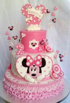 A very beautiful Minnie mouse birthday cake in pink and with a Minnie mouse head. A very beautiful Minnie mouse birthday cake in pink and with a Minnie mouse head topping. Torta Minnie Mouse, Minnie Mouse Birthday Cakes, Bolo Minnie, Minnie Cake, Mickey Cakes, Mickey Mouse Cake, Baby Birthday Cakes, Mickey Birthday, Birthday Kids