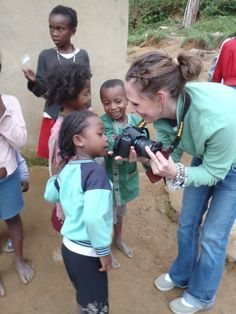 Megan Gardner (2011) sharing her photos with a young girl in the village of Ambatolahy, outside of Ranomafana National Park in southeastern Madagascar.