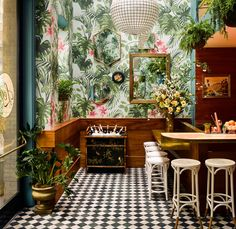 Two (Green) Thumbs Up Succulents are quickly losing ground to restaurants' latest botanical obsession: tropical plants. Just look at Leo's Oyster Bar in San Francisco, which doubles down with tropical wallpaper.